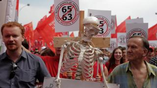 a skeleton is brought on a demonstration against pension reform