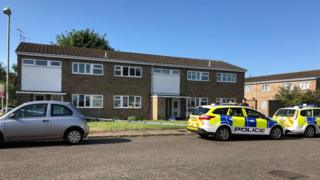 Police cars outside a home in Lowestoft, Suffolk