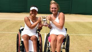 Jordanne and Yui holding their Wimbledon trophy