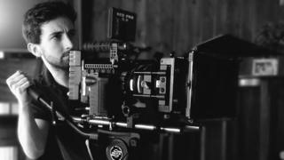 Jack Walsh filming with a camera