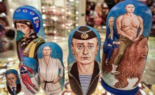 A picture shows traditional Russian wooden nesting dolls, Matryoshka dolls, depicting Russian President Vladimir Putin