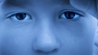 Stock image - close up of a child's eyes looking sad