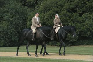 Queen Elizabeth II riding in the grounds of Windsor Castle with US President Ronald Reagan, during his state visit to the UK, 8 June 1982