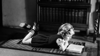 Girl reading on the floor