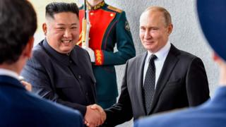 Kim Jong-un and Vladimir Putin shaking hands