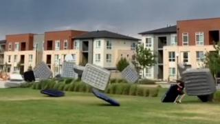 Dozens of air mattresses are swept away by the wind before an outdoor movie night in Colorado.