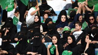 Saudi women sit in a stadium for the first time to attend an event