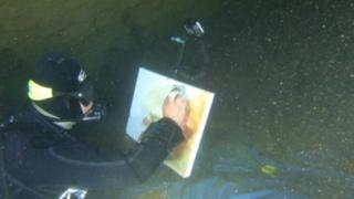 Philip Gray painting under water at Wookey Cave