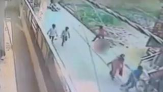 CCTV footage showing the attacker standing over the woman, with the woman blurred from shot