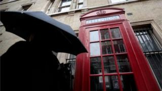 A British Telecoms public telephone box is pictured in central London