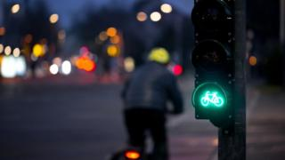 Cyclist at green light
