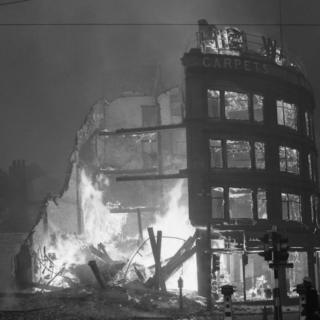 Burning buildings in Manchester after a German air raid