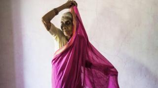 Ansuya Deshmukh putting on sari