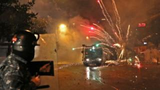 Young Shia men throw fireworks at security forces in Beirut, Lebanon (17 December 2019)