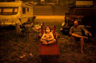 A family sit at a showground