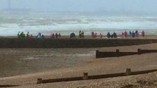A group of school children on the beach at Hill Head as Storm Imogen hit