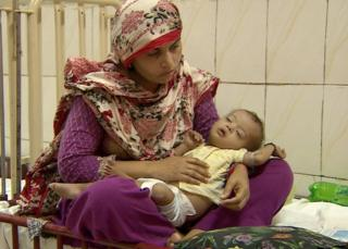 a mother cares for her child in a Pakistan hospital - September 2015