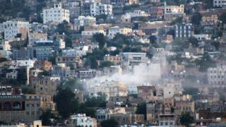 Smoke rises from buildings hit by shellfire in Taiz, Yemen, (21 October 2015)