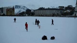 Icelandic cricketers playing on a snowy pitch