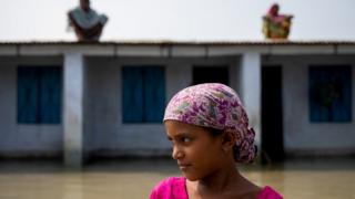 A-flood-affected-girl-outside-a-house-in-Bangladesh.