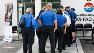 Federal workers line up at a pop-up food pantry in Tampa, Florida
