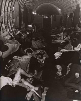 A photograph of people sleeping in an underground Blitz shelter