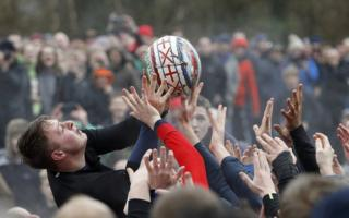 Players compete for the ball during the annual Shrovetide football match in Ashbourne, 28 February 2017