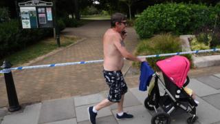 Man walks past cordon in city