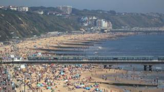 People enjoy the hot weather at Bournemouth beach in Dorset on 20 May