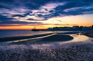 A beach at dawn