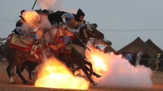 Horsemen ride in a choreographed cavalry charge during a Berber festival in Tan-Tan, Morocco - 8 July 2018
