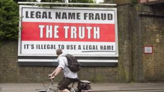 """Legal name fraud"" poster in London"