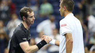 Andy Murray shakes hands with Lukas Rosol