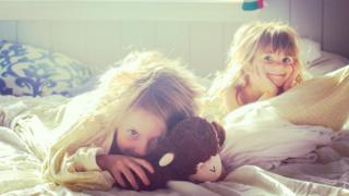 Two girls waking up