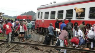 Survivors leaving a train crash site in Cameroon.