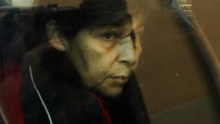 "Patricia Dagorn, a woman suspected of being a serial poisoner trapping wealthy widowers coming from the Cote d""Azur, is actually seen in a car as she arrives at court in Nice, south-eastern France, on 15 January 2018 to attend her trial"