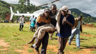 A wounded survivor is evacuated by helicopter from Chimanimani on March 19, 2019 to an hospital in Mutare,