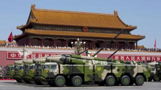 Chinese military vehicles carrying DF-21D anti-ship ballistic missiles, potentially capable of sinking a U.S. Nimitz-class aircraft carrier in a single strike, travel past Tiananmen Gate during a military parade to commemorate the 70th anniversary of the end of World War II in Beijing Thursday Sept. 3, 2015.