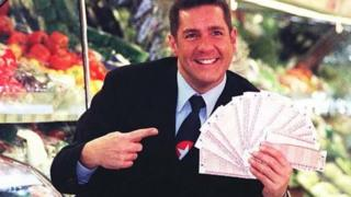 "Dale Winton doing a ""Supermarket Sweep"" in 1997 to promote the National Lottery"