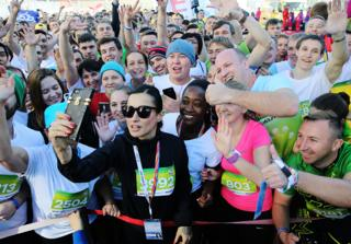 SEPTEMBER 16, 2017: Match TV General Producer Tina Kandelaki (C front) makes a selfie with participants in the Festival 2017-metre Race as part of the 2017 World Festival of Youth and Students at the Sochi Formula 1 track.