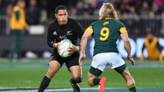 Aaron Smith of the All Blacks is tackled during the Rugby Championship match