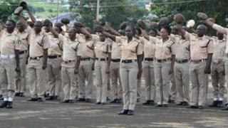 Di members of di Nigeria Immigration Service