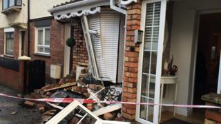 Damage caused to house by stolen car.