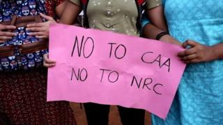 Indian protesters hold sign saying 'No to CAA, No to NRC'