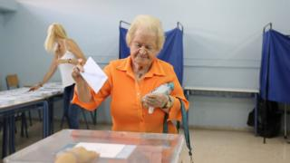 A woman votes in Greece, 7 July 2019