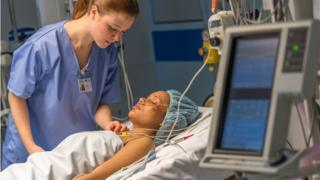 Doctor looking after critically ill patient