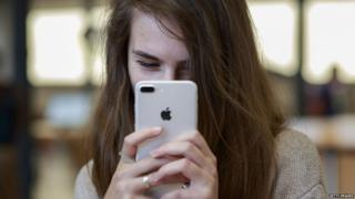 Girl takes selfie with iPhone 7