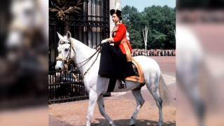 Queen riding side-saddle at the ceremony in 1963