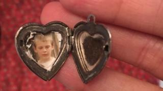 The locket Fiona Leahy found in Oxfam which contains a photo of a young boy