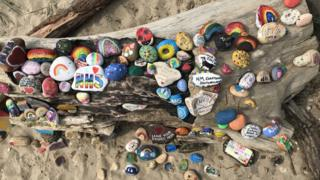 Painted pebbles on Avon Beach in Dorset
